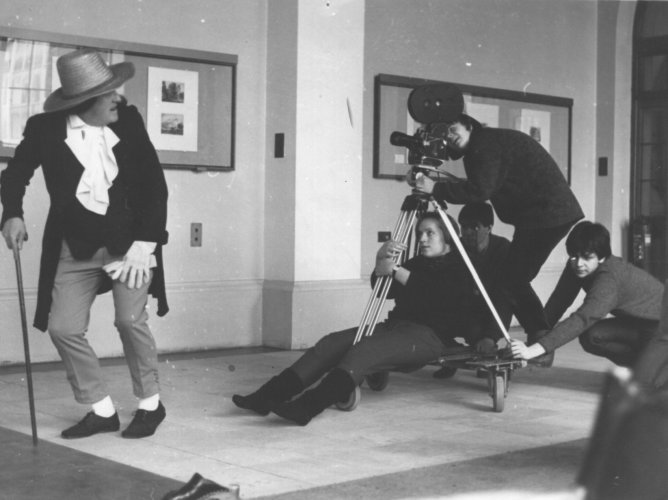 ''Filming in the Cloisters for Newsreel 68 Gerhild Schiller behind Camera, Ingid Frost on Dolly, Johnathon Plummer Pushing dolly near Cam, Phil Bealer pushing dolly far side, Jim Hunnigan - Jeremy Bentham's Ghost''