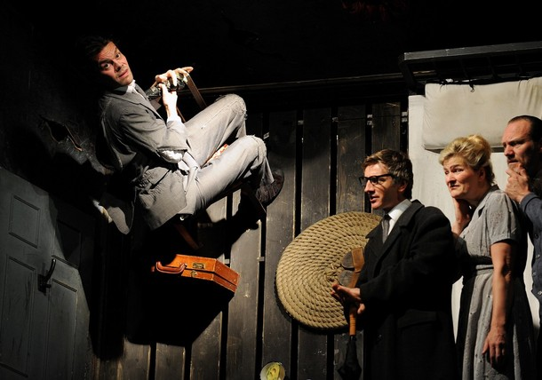 "''Actor Bjorn Thors (L) who plays ""Gregor"", joins other cast members as they perform an excerpt on the upstairs part of a split-level set which has been tipped on its side, from the play ""Metamorphosis"" at the Sydney Theatre on April 22, 2009. Metamorphosis is based on Franz Kafka's bizarrely comic and most well-known story set in Prague in the mid-twentieth century, where the unremarkable life of the Samsa family is turned upside down when their son, Gregor, emerges one morning inexpicably transformed into a monstrous insect. The upstairs part of the set is tipped on its side so that actor Bjorn Thors can literally climb the walls.''"