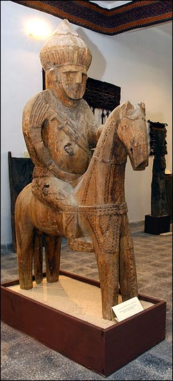''The wooden statues from Nuristan, one of Afghanistan's mountainous northeastern provinces, are an apt subject for an inaugural exhibition. Museum staff had worked hard to hide the collection from looters and Islamic fundamentalists intent on destroying all idols and artistic depictions of the human form. The figures, from what was formerly known as Kafiristan, or Land of the Heathens, are ancestor effigies and animistic and polytheistic gods, representing beliefs and traditions that were practiced there little more than 100 years ago.''