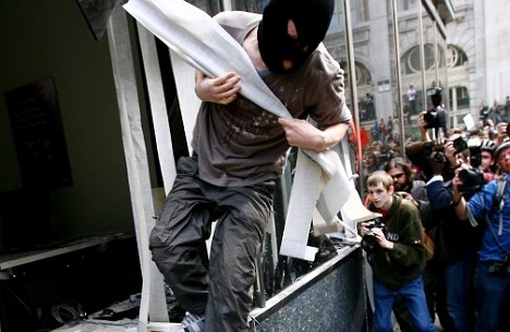 """Paul Joseph Watson ''The British authorities seemed to have little problem with allowing a group of violent black bloc anarchists smash up the RBS building while provoking police yesterday, despite the group announcing their target in advance, yet a legitimate anti-poverty organization has had its """"accreditation"""" to protest at the G20 removed on the orders of Downing Street. This once again underscores the completely undemocratic power of the government to decide who is allowed to protest against them and who is not. When you have to get permission from the government to exercise a God-given right, as in China or Russia, then we know we are already living in a police state. The freedom to protest is not one that has to be """"accredited"""" by the state, a license to protest as it were, it is an innate human right.'' prison planet. com"""
