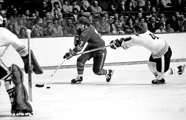 BOSTON, MA. - 1970's: Rick Martin #7 of the Buffalo Sabres skates past Bobby Orr #4 of the Boston Bruins at the Boston