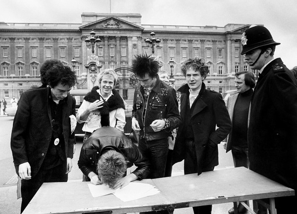 """pulmyears.files Sex Pistols signing. Paul Myers: ''Malcolm McLaren is remembered largely as """"an entrepreneur"""" or a """"manager"""" but such a limited appellations are about as useful as describing P.T. Barnum a """"show producer."""" McLaren also staged The Greatest Shows on Earth, in his heyday, and up until yesterday, he was a living legend and would have been the first to tell you that. And why, on earth, wouldn't he take credit for it? The man worked damn hard at becoming Malcolm McLaren. He was many things, culture appropriator, manager, exploiter and charlatan. But you know what, financial matters aside (I'm thinking of the embittered former Sex Pistol Steve Jones), he was never a liar. The whole """"punk rock mythos"""" of being up front when you sell out and being openly greedy and selfish in demanding attention, was not a lie. Unlike most others in the shallow business of show, McLaren's biggest con was that it wasn't just a scam, it was all real.''"""