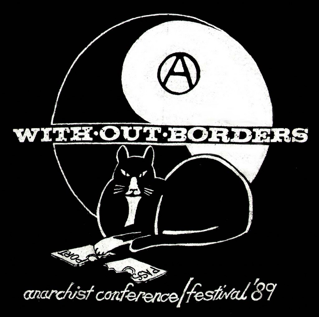 """''The first recorded use of the A in a circle by anarchists was by the Federal Council of Spain of the International Workers Association. This was set up by Giuseppe Fanelli in 1868. It predates its adoption by anarchists as it was used as a symbol by amongst others. According to George Woodcock, this symbol was not used by classical anarchists. In a series of photos of the Spanish Civil War taken by Gerda Taro a small A in a circle is visible chalked on the helmet of a militiaman. There is no notation of the affiliation of the militiaman, but one can presume he is an Anarchist. The first documented use was by a small French group, Jeunesse Libertaire (""""Libertarian Youth"""") in 1964. Circolo Sacco e Vanzetti, youth group from Milan, adopted it in and in 1968 it became popular through out Italy. From there it spread rapidly around the world.''"""